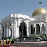 Spending spree: An inauguration ceremony is held in May 2011 for the presidential palace complex in the capital of Turkmenistan, Ashgabat. | AFP-JIJI