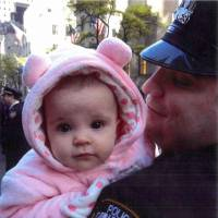 Emotive evidence: Gilberto Valle holds his daughter in a photo submitted as evidence on the opening day of his trial in New York on Monday. | AP