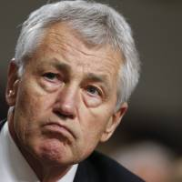 Hagel lands defense post but fails to win over opponents