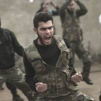 Up in arms: Syrian rebels attend a training session in Maaret Ikhwan, near the opposition stronghold of Idlib, in December. | AP