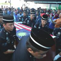 Fresh clashes in Borneo siege leave seven more dead