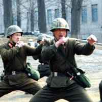 Militant posturing: Soldiers train at an undisclosed location in North Korea in March. | AFP-JIJI