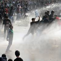 Incendiary issue: Indian police fire a water cannon against protesters during a December rally calling for enhanced safety for women after the fatal gang-rape of a student in New Delhi. | AFP-JIJI