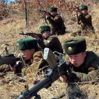 Killing field: North Korean soldiers aim their weapons during exercises Wednesday. | AFP-JIJI