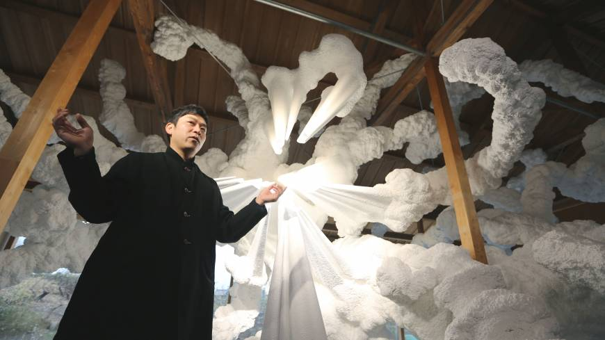 Kohei Nawa speaks in front of his artwork displayed at 'F-Art House,' a traditional Japanese-style house at Inujima.