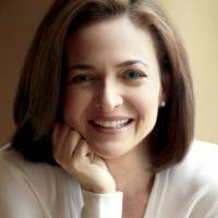 Been there, done that: Facebook COO Sheryl Sandberg and Chelsea Clinton, daughter of former U.S. President Bill Clinton, arrive at a bookstore in New York on March 12 to promote Sandberg's 'Lean In,' a new book of career advice for women. | BLOOMBERG