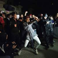 Shakedown: Protesters do the 'Harlem Shake' at the headquarters of the Muslim Brotherhood in Cairo. | AFP-JIJI