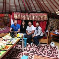 Local feast: Midori Paxton (in black) with a UNDP colleague, project staff and a local community member in a ger, or yurt, in Mongolia. | MIDORI PAXTON