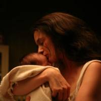 Leonie Gilmour (Emily Mortimer) holds her newborn son in a scene from the film. | © LEONIE PRODUCTIONS, INC