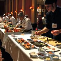 Prepping to win: Pepi Anevski (front), of Umami restaurant in Copenhagen, was named Chef of the Year at Japan's first World Sushi Cup for his winning dish of season-inspired sushi. | MELINDA JOE