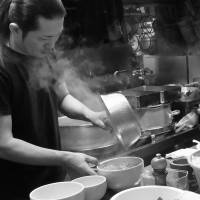 Chef Tsukasa Hasunuma creates a bowl of ramen at his restaurant Gamushara in Hatagaya, Shibuya. | HIROSHI SHIMAKAGE
