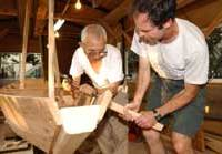 Douglas Brooks (left) and his 'master,' Kazuyoshi Fujiwara build a traditional tenmasen cargo boat together in their Tokyo workshop.