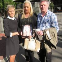 A family devastated: Andrea Furlong holds a picture of her late sister, Nicola, with parents Angela and Andrew outside the  Tokyo District Court. | DAVID MCNEILL