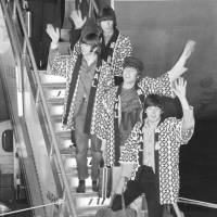 Enjoy it while it lasts:  The Beatles — George Harrison, Ringo Starr, John Lennon and Paul McCartney — disembark at  Tokyo's Haneda airport on June 29, 1966, wearing the JAL happi coats that flight attendant Satoko Kawasaki (now Condon) gave to Lennon. Kawasaki was given the job of looking after the Beatles on one condition: that she would try her utmost to persuade them to don the coats on arrival, in what son Mark calls 'the greatest (free) advertising in aviation history.' | KYODO