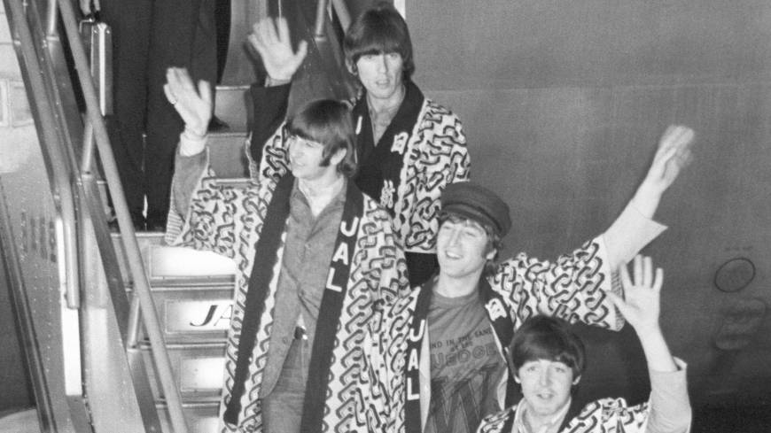 Enjoy it while it lasts:  The Beatles — George Harrison, Ringo Starr, John Lennon and Paul McCartney — disembark at  Tokyo's Haneda airport on June 29, 1966, wearing the JAL happi coats that flight attendant Satoko Kawasaki (now Condon) gave to Lennon. Kawasaki was given the job of looking after the Beatles on one condition: that she would try her utmost to persuade them to don the coats on arrival, in what son Mark calls 'the greatest (free) advertising in aviation history.'