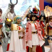 Into the spirit: Tokyo International Anime Fair attendees dress up as their favorite characters from anime. | YOSHIAKI MIURA