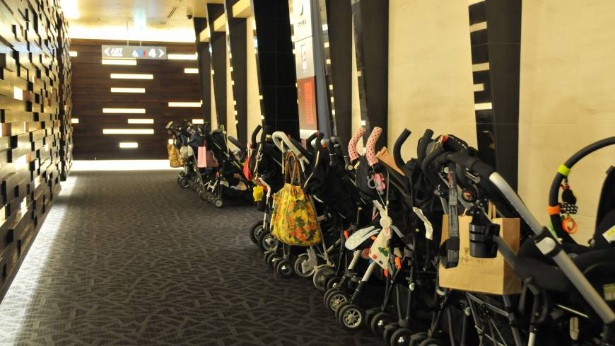 At the drive-in: Handy baby-stroller parking at Mama's Club Theater.