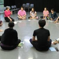 Captive audience: Resident instructor Lorna Marshall speaks to students at the New National Theatre, Tokyo's Drama Studio. | NOBUKO TANAKA