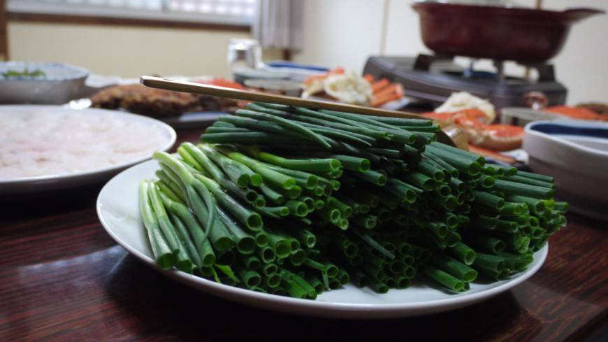 For its cuisine — which includes green onions sometimes served as shabu-shabu