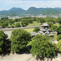 Ancient horizons: A view of the Kyushu volcanos beyond the city of Kumamoto, as seen from the top of the castle.