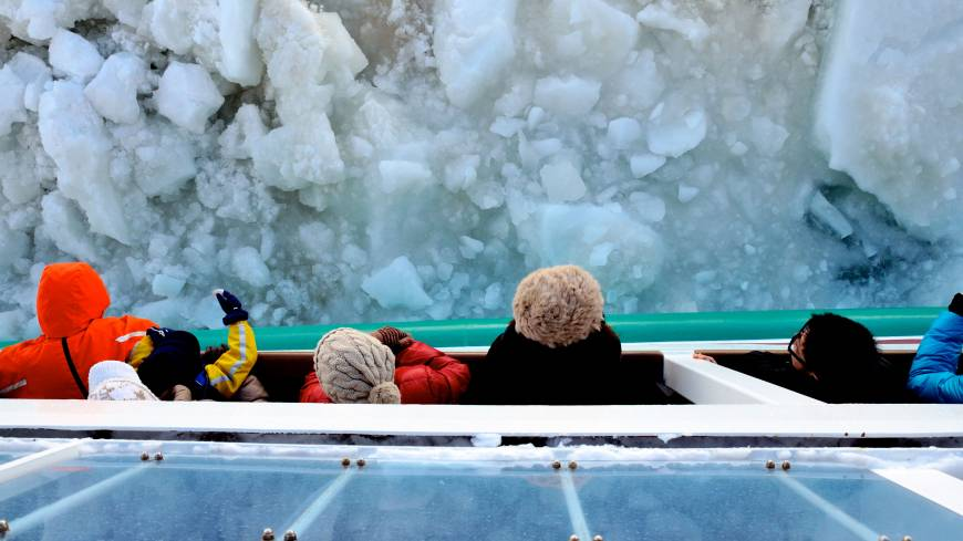 Ice blocks: Tourists lean out the Icebreaker Aurora II to better hear the haunting crush of drift ice as the ship grinds through.