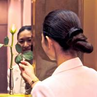 VIP service specialist Mina Tamaki, who changes the fresh rosebuds in the hotel's elevators thrice daily. | KIT NAGAMURA