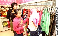 Ayari Matsui, 10, and her mother Eri, check out clothes at a new shop targeting preteen  girls near JR Harajuku Station in Tokyo.