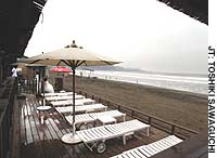 Sun loungers on Yuigahama Beach, a popular summer spot in Kamakura, Kanagawa Prefecture, sit vacant thanks to the prolonged rainy season.