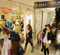 Eager for a deal: Customers stroll through the north building of Daimaru's Shinsaibashi branch in Osaka, which opened Nov. 14. The first and second basement floors offer reasonably priced clothing brands aimed at young women. | KYODO PHOTO