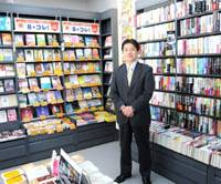 Author of change: Hiroshi Sato, president and chief executive officer of secondhand book trader Bookoff Corp., poses at an outlet in Sagamihara, Kanagawa Prefecture, last month. | SATOKO KAWASAKI PHOTO