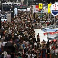 Still impressed: Crowds throng the exhibition area at the Shanghai International Auto Show on April 22. Toyota still has a relatively good reputation in China despite massive product recalls it has recently issued around the world. | AP PHOTO