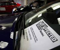 Not a total recall: A sign on a 2010 Camry on display at Toyota Motor Corp.'s New York showroom earlier this month assures customers the car has not been affected by the recent recalls. | AP PHOTO