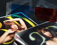 XXXx3: A pair of 3-D glasses and pornographic DVDs for 3-D format TVs are displayed in Tokyo on Monday. | BLOOMBERG