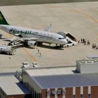 Springboard: The first chartered Spring Airlines flight to serve Ibaraki Airport arrives from Shanghai on July 28. The Chinese low-cost carrier is new to the Japanese market. | KYODO PHOTO