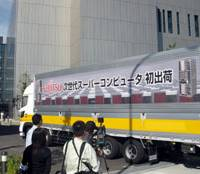 Handle with care: A truck loaded with components for Fujitsu Ltd.'s next-generation supercomputer enters a Riken facility in Kobe. | KYODO PHOTO