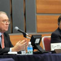 Murray McLean (left), Australia's ambassador to Japan, speaks during the Sept. 27 symposium at Keidanren Kaikan in Tokyo while APEC Executive Director Muhamad Noor looks on. | SATOKO KAWASAKI PHOTO