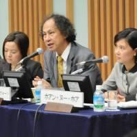 Kavi Chongkittavorn (center) of The Nation daily in Thailand discusses Japan's relations with Southeast Asia during the Oct. 15 symposium at Keidanren Kaikan in Tokyo while Susan Long (left) of The Straits Times and Hoang Nhu Hoa of Viet Nam News listen. | SATOKO KAWASAKI PHOTOS