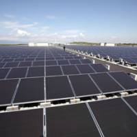 Let it shine: Solar panels manufactured by Sharp Corp. make electricity at Kansai Electric Power Co.'s mega solar power station in Sakai, Osaka Prefecture, in October. | BLOOMBERG PHOTO