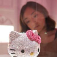 Go figure: A Sanrio Co. Hello Kitty figure made of Swarovski crystals is displayed during the 'House of Hello Kitty' event at Omotesando Hills in Tokyo on June 29. | BLOOMBERG