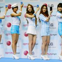 Sales pitch: Kara, a female Korean dance and music group, promotes LG Electronics' smartphones in Tokyo in June. | KYODO