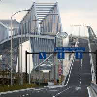 Traffic cutter: The Tokyo Gate Bridge, nicknamed the 'Dinosaur Bridge,' officially opens Sunday and is aimed at slashing traffic congestion and boosting the capital's economy. | BLOOMBERG