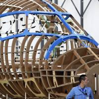 Freedom to fly: A mockup of the forward fuselage frame of the Mitsubishi Regional Jet is displayed during a ceremony to commence assembly operations at Mitsubishi Aircraft Corp.'s plant in Aichi Prefecture last April. | BLOOMBERG