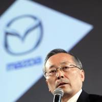 Future plans: Mazda Motor Corp. Chief Executive Officer Takashi Yamanouchi speaks at the launch ceremony for the new CX-5 sport utility vehicle in Tokyo in February. | BLOOMBERG