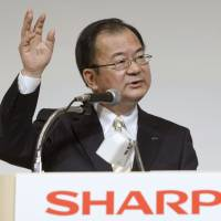 In partnership: Takashi Okuda, who became president of Sharp Corp. in April, announces March 27 in Tokyo a capital alliance with Taiwan's Hon Hai Precision Industry Co. | KYODO