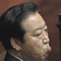 Like a nervous father: Prime Minister Yoshihiko Noda awaits the Lower House vote Tuesday on his consumption tax hike. | AP