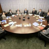 Bankers of the round table: Bank of Japan Gov. Masaaki  Shirakawa (center) and other members of the BOJ Policy Board pose for a photograph before they start a policy meeting Thursday. | KYODO