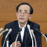 Feeling the squeeze: Bank of Japan Gov. Masaaki Shirakawa faces reporters in Tokyo on July 12. | BLOOMBERG