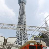 Towering achievement: A special train marking the 100th day since the opening of  Tokyo Skytree stops at  Tobu Railway Co.'s  Tokyo Skytree Station on Aug. 29. | KYODO