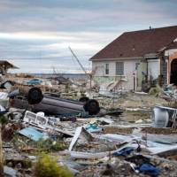 Trapped in time: Debris clogs streets and yards Saturday in Union Beach, New Jersey, five days after Superstorm Sandy swooped in to wreak widespread destruction, flooding and power outages. | BLOOMBERG