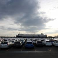 On the next tide: Toyota Motor Corp. cars, including Aqua hybrid compacts, wait to be loaded Friday at Sendai port. | BLOOMBERG